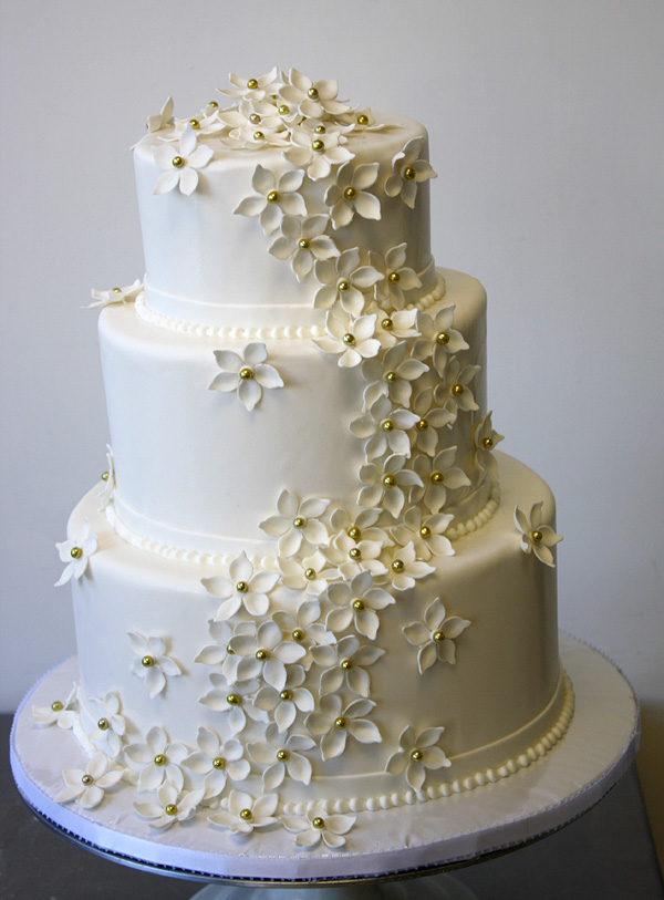 Wedding Cake with Cascade of Blossoms by CakeSuite serving