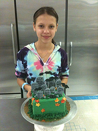 Student with cake